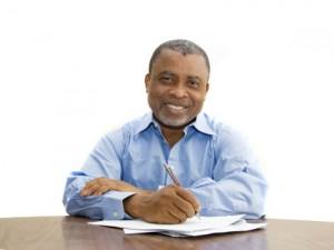smiling-man-at-desk2